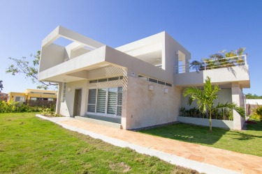 2 bedroom, 2 story villa with a glimmer of ocean view, gated community, live a great life, property in the DR, rental potential